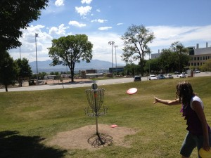 Putt going into basket at University of Utah Disc Golf Course